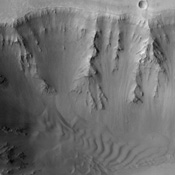 This image from NASA's Mars Odyssey spacecraft, which displays clearly the contrast between bedrock, sand, and dust surfaces, covers a portion of Coprates Chasma, part of the Valles Marineris system of canyons that stretch for thousands of kilometers.
