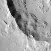 This crater within part of Amazonis Planitia was captured by NASA's Mars Odyssey spacecraft and displays a number of common features exhibited by Martian craters.
