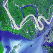 These images show dramatic change in the water at Dongting Lake in Hunan province, China between August and September of 2002. NASA's Terra satellite captured this image on September 2, 2002 and March 19,.2002.