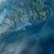 The Florida Keys are a chain of islands, islets and reefs extending from Virginia Key to the Dry Tortugas. This image was acquired by NASA's Terra satellite on October 28, 2001.