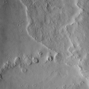This NASA Mars Odyssey image covers a large area over the summit of Ulysses Patera, one of the many volcanoes that make up the giant Tharsis volcanic province, although Ulysses itself is fairly small in comparison to the other volcanoes in this area.