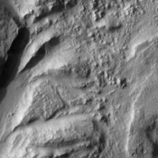 This image of Hydaspis Chaos from NASA's Mars Odyssey spacecraft shows the source terrain for several outflow channels on Mars.