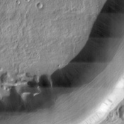 This NASA Mars Odyssey image shows Dao Vallis, a large outflow channel that starts on the southeast flank of a large volcano called Hadriaca Patera and runs for 1,000 kilometers (about 620 miles) southwest into the Hellas impact basin.