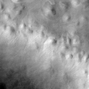 Hills abound in this portion of Mars imaged by NASA's Mars Odyssey that shows the Vastitas Borealis region of the high northern plains. These hills are part of Scandia Colles.