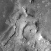 Much of the northern lowlands of Mars are thought to be relatively young volcanic flows with varying amounts of windblown dust cover. The lack of impact craters in this image from NASA's Mars Odyssey spacecraft indicate the young age of the surface.