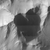 This image from NASA's Mars Odyssey spacecraft covers part of Tithonium Chasma, which is part of the Valles Marineris system of canyons that stretch for thousands of kilometers.