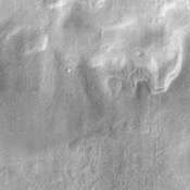 This NASA Mars Odyssey image was taken during winter in the southern hemisphere, meaning that the usually cloudy Hellas Basin is relatively free from clouds.