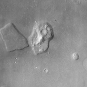 The Cydonia region on Mars, seen in this image from NASA's Mars Odyssey spacecraft, straddles the boundary between the bright, dusty, cratered highlands to the southeast and the dark, relatively dust-free, lowland plains to the west.