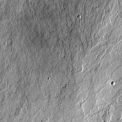 Like drippings from a candle, these lava flows on the flank of Olympus Mons volcano, seen in this image from NASA's Mars Odyssey spacecraft, demonstrate how it became the largest volcano in the solar system.