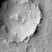 Dark streaks emanating from within impact crater walls show evidence for mass movement of materials in this image from NASA's Mars Odyssey spacecraft.