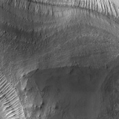 Erosion of the interior layered deposits of Melas Chasma, part of the huge Valles Marineris canyon system, has produced cliffs with examples of spur and gulley morphology and exposures of finely layered sediments, as seen in this NASA Mars Odyssey image.