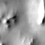 The muted terrain of northern Acidalia Planitia, as seen in this image from NASA's Mars Odyssey spacecraft, testifies to the fact that the region is heavily mantled with dust.