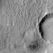 The floors of these craters imaged by NASA's Mars Odyssey contain very interesting and enigmatic materials that may hold shallow subsurface ground ice with varying amounts of a sediment covering (mantle).