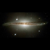 NASA's Hubble Space Telescope has imaged an unusual edge-on galaxy, revealing remarkable details of its warped dusty disc and showing how colliding galaxies trigger the birth of new stars.