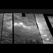 Images from NASA's Mars Odyssey spacecraft were used to create this mosaic of nighttime infrared images of Gusev Crater, which has been draped over topography data obtained by NASA's Mars Global Surveyor.