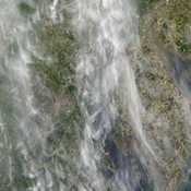 During Spring 2003, students, teachers, and scientists worked side-by-side, measuring the properties of aerosols (fine particulate matter suspended in the air) over Baltimore, Maryland using hand-held instruments shown here by NASA's Terra spacecraft.