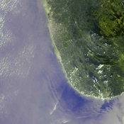 The initial tsunami waves resulting from the undersea earthquake that occurred at 00:58:53 UTC (Coordinated Universal Time) on 26 December 2004 off the island of Sumatra, Indonesia, as seen by NASA's Terra spacecraft.