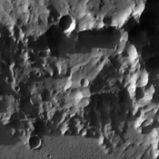 The impact crater observed in this NASA Mars Odyssey image taken in Terra Cimmeria suggests sediments have filled the crater due to the flat and smooth nature of the floor compared to rougher surfaces at higher elevations.