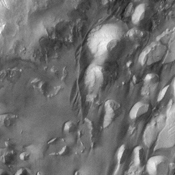 The top half of this NASA Mars Odyssey image shows interior layered deposits that have long been recognized in Valles Marineris. Upon close examination, the layers appear to be eroding differently, indicating different levels of competency.
