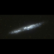 This image of the nearby edge-on spiral galaxy NGC 55 was taken by NASA's Galaxy Evolution Explorer on September 14, 2003, during 2 orbits. This galaxy lies 5.4 million light years from our Milky Way galaxy.