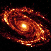 The magnificent and dusty spiral arms of the nearby galaxy Messier 81 are highlighted in these NASA Spitzer Space Telescope images.