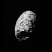 This image was taken during the close approach phase of NASA's Stardust's Jan 2, 2004 flyby of comet Wild 2. It is a distant side view of the roughly spherical comet nucleus.