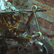 Footage taken at the JPL In-Situ Instruments Laboratory, or 'testbed,' shows engineers practicing the deployment of the test rover's robotic arm.
