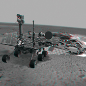 This 3-D image combines computer-generated models of NASA's Mars Exploration Rover Spirit and its lander with real surface data from the rover's panoramic camera. 3D glasses are necessary to view this image.