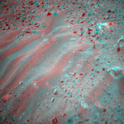 This is a three-dimensional stereo anaglyph of an image taken by the front navigation camera onboard NASA's Mars Exploration Rover Spirit, showing an interesting patch of rippled soil. 3D glasses are necessary to view this image.