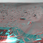 NASA's Mars Exploration Rover Spirit took this 3-D navigation camera mosaic of the crater called 'Bonneville.' The rover's solar panels can be seen in the foreground. 3D glasses are necessary to view this image.