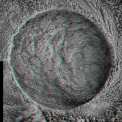 This 3-D, microscopic imager mosaic of a target area on a rock called 'Diamond Jenness' was taken after NASA's Mars Exploration Rover Opportunity ground into the surface with its rock abrasion tool for a second time. 3D glasses are necessary.