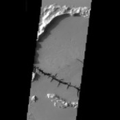 This image from NASA's Mars Odyssey spacecraft shows a barbed wire-like feature on the surface of Mars.