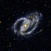 This ultraviolet image from NASA's Galaxy Evolution Explorer shows the interacting pair NGC 1097, a barred spiral galaxy, and the small elliptical companion galaxy NGC 1097A.