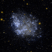 This ultraviolet image (left) and visual image (right) from NASA's Galaxy Evolution Explorer is of the irregular dwarf galaxy IC 1613.