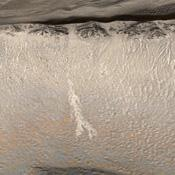 Two Martian southern mid-latitude craters have new light-toned deposit that formed in gully settings during the course of the Mars Global Surveyor mission.