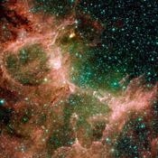 This set of images from NASA's Spitzer Space Telescope shows the Eagle nebula in different hues of infrared light. Each view tells a different tale.