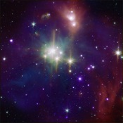 This composite image shows the Coronet in X-rays from Chandra and infrared from NASA's Spitzer Space Telescope (orange, green, and cyan). The Spitzer data show young stars plus diffuse emission from dust.