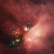 Newborn stars peek out from beneath their natal blanket of dust in this dynamic image of the Rho Ophiuchi dark cloud from NASA's Spitzer Space Telescope. This nebula is about 407 light years away from Earth.