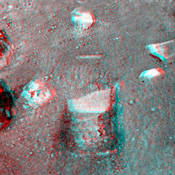 This anaglyph image, acquired by NASA's Phoenix Lander's Surface Stereo Imager on June 1, 2008, shows a stereoscopic 3D view of the so-called 'Knave of Hearts' first-dig test area to the north of the lander. 3D glasses are necessary to view this image.