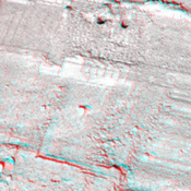 This view from NASA's Phoenix Mars Lander shows a portion of the trench informally named 'Snow White,' with two holes near the top of the image. 3D glasses are necessary to view this image.