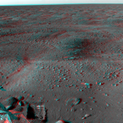 This anaglyph was acquired by NASA's Phoenix Lander; in the bottom left is a trench dug by Phoenix's Robotic Arm. In the bottom right is one of Phoenix's two solar panels. You will need 3-D glasses to view this image.