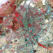 A historic capital city, Madrid, Spain is renowned for its unique charm and its exhilarating cultural life. This image was acquired by NASA's Terra satellite on July 5, 2000.
