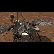This frame from an animation shows NASA's Phoenix Lander's Robotic Arm scoop delivering a sample to the Thermal and Evolved-Gas Analyzer (TEGA) and how samples are analyzed within the instrument.
