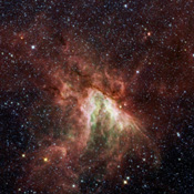 NASA's Spitzer Space Telescope has captured a new, infrared view of the choppy star-making cloud called M17, or the Swan nebula.
