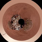This view is a polar projection that combines more than 500 exposures taken by the Surface Stereo Imager camera on NASA's Mars Phoenix Lander and projects them as if looking down from above.