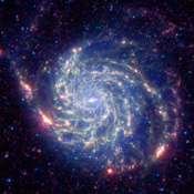 The galaxy Messier 101 is a swirling spiral of stars, gas, and dust. Messier 101 is nearly twice as wide as our Milky Way galaxy in this image as seen by NASA's Spitzer Space Telescope.