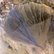 NASA's Terra spacecraft shows vast alluvial fan blossoms across the desolate landscape between two mountain ranges that form the southern border of the Taklimakan Desert in China's XinJiang Province.