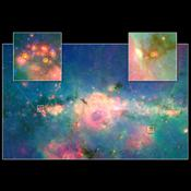 This infrared image from NASA's Spitzer Space Telescope shows three baby stars in the bustling center of our Milky Way galaxy. The three stars are the first to be discovered in the region.