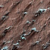 NASA's Mars Reconnaissance Rover spied these spider-like formations, likely caused as carbon dioxide ice changes from a solid to a gas; the gas moves through channels until it reaches the surface and vents out.