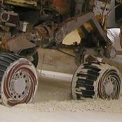 Mike Seibert and Sharon Laubach, engineers on NASA's Mars Exploration Rover team at the Jet Propulsion Laboratory, Pasadena, check the exact position of a test rover in preparation for the next test of a possible maneuver for Spirit to use on Mars.